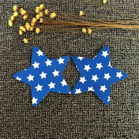 Blue star-shaped nipple stickers with small white stars.