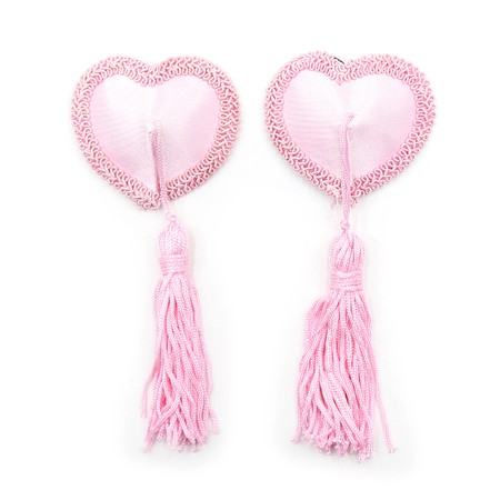 Heart-shaped pink nipple covers in a burlesque style with tassels